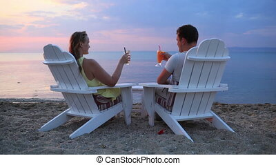 Romantic couple toasting the sunset - Romantic couple...
