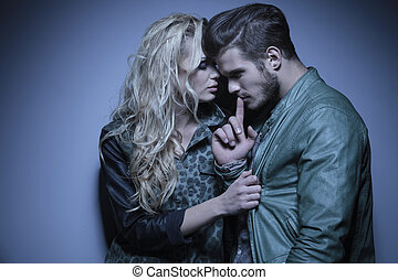 woman embracing her thoughtful boyfriend - young fashion...