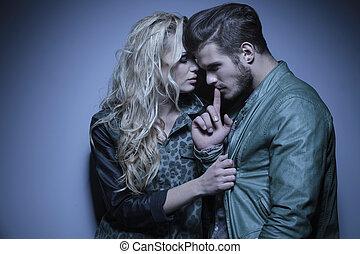 woman embracing her thoughtful boyfriend - young fashion...