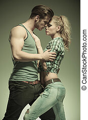 fashion man embracing his girlfriend in a passionate pose,...