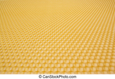 beeswax - close up structure of yellow beeswax as background