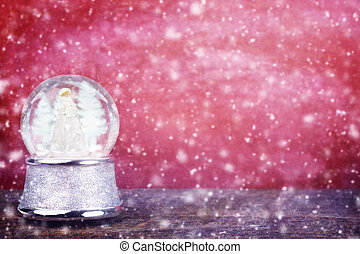 Snowglobe Against Red - Silver snowglobe against a red...