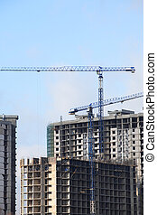 Constraction Cranes - View of house-building with...