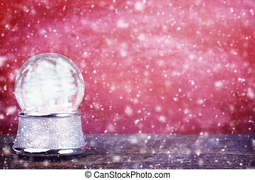 Empty Snowglobe Against Red - Empty Silver snowglobe against...
