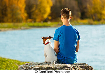 boy and dog - boy and his dog sitting together enjoying the...