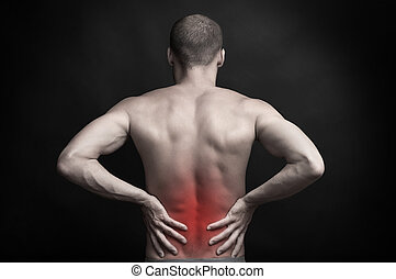 man holding aching back with hands - strong muscular man...