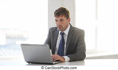 businessman working with laptop computer - technology,...