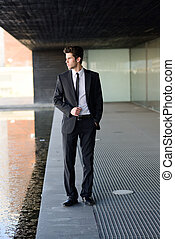 Attractive young businessman in urban background - Portrait...