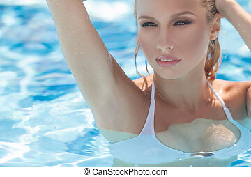 Sexy women in pool. Beautiful young women swimming in a pool