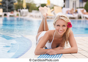 Summer girl. Attractive young women in bikini lying on the...
