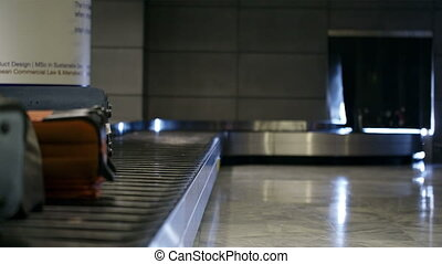 Baggage conveyor belt in the airport carrying the passenger...