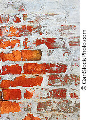 Old brick wall covered with cement and lime - Old wall from...