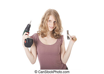 young woman with hammer and drill against white background