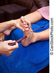 spa foot treatment by wood stick