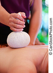 massage with spa herbal compress balls