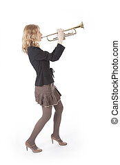 young pretty woman playing the trumpet