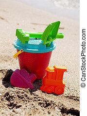 plastic toys on the beach