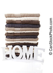 Pile of towels over white background