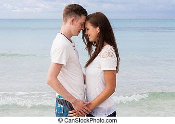attractive young couple in love having fun in summer...