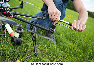 Technician Tightening Propeller Of UAV Drone - Closeup of...