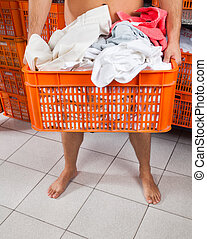Semi Nude Man Carrying Basket In Laundry - Low section of...