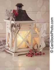 Burning lantern and christmas decoration on white background