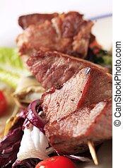 Pork skewer with vegetables - Pork shish kebab and vegetable...