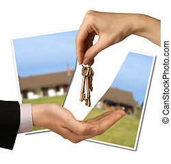 broken deal - torn photograph of a house behind hands...