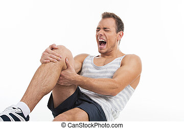 Man screaming from a pain in his knee. While isolated on...