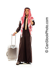 Young smiling arab with a suitcase and thumb up isolated on...