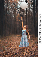 Girl with a balloon in the forest - Young beautiful girl...