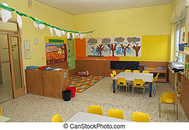 classroom in a kindergarten with tables and yellow chairs -...