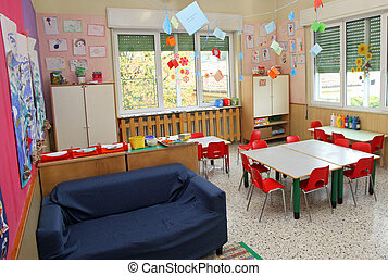 classroom in a kindergarten with tables and little chairs...