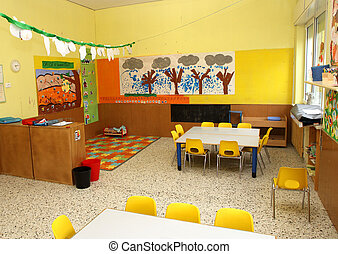 classroom in a kindergarten with little chairs for the...