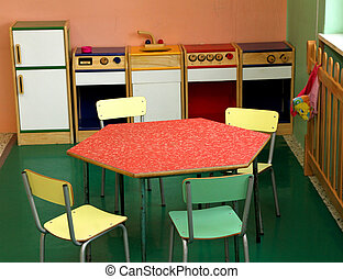 Toy kitchen and chairs to play in a nursery - Toy kitchen...