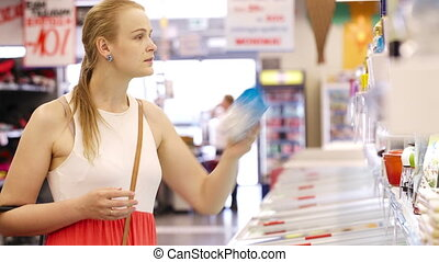 Young woman buying products at the supermarket