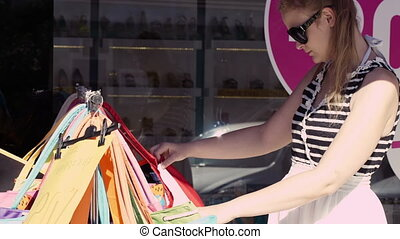 Woman shopping for bags