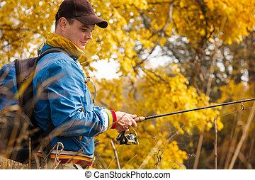 Fisherman with spinning. - Fisherman with spinning - autumn...