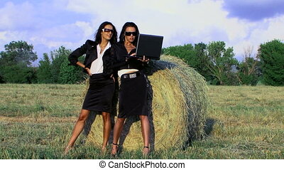 Businesswomen - Two businesswomen in a field