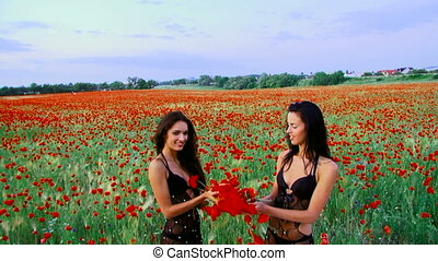 Poppy bouquets - Two women throwing poppy flowers in the air