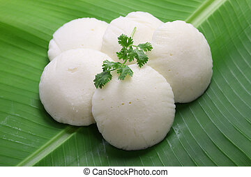idli, south indian rice cake on banana leaf