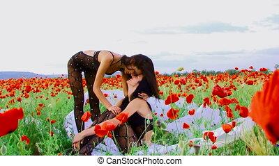 Posing in a field - Two women posing in a poppy field