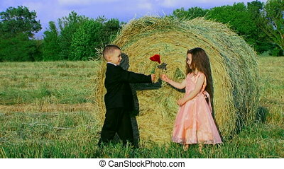 Countryside romance - Children in a field pretending to be...