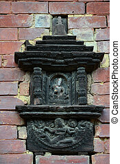 Carved wooden details on brick wall