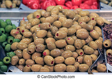 Green olives in food store - Green olives on a stand in food...