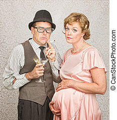 Worried Pregnant Couple - Worried man with martini and...