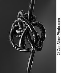 Tangled - Black and white image of a black tangled flexible...