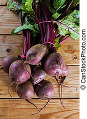 Beetroot - Fresh, organic raw beetroot against a wooden...