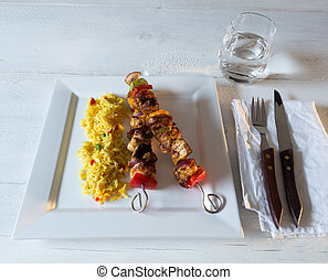 Chicken skewers with curry rice