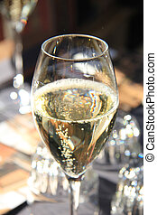 Sparkling Champagne - Glass of sparkling champagne at a...